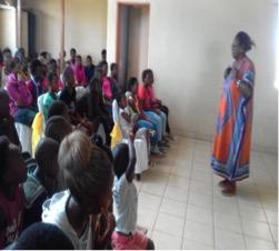 70. Ma Flo addressing children