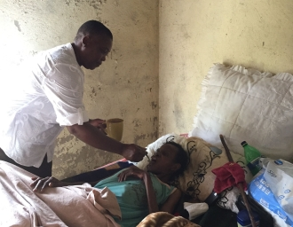 21. Feeding a sick woman