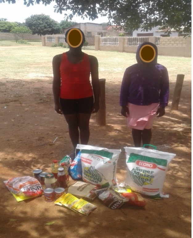 Siphi.&Ali. Ngo. receiving a food parcel